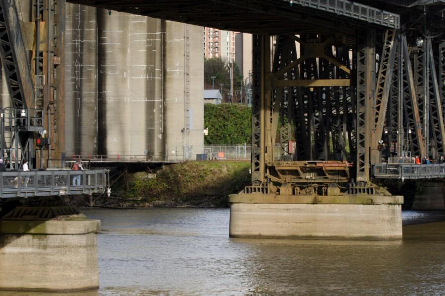 Walkway under Steel Bridge open to allow vessel to pass through