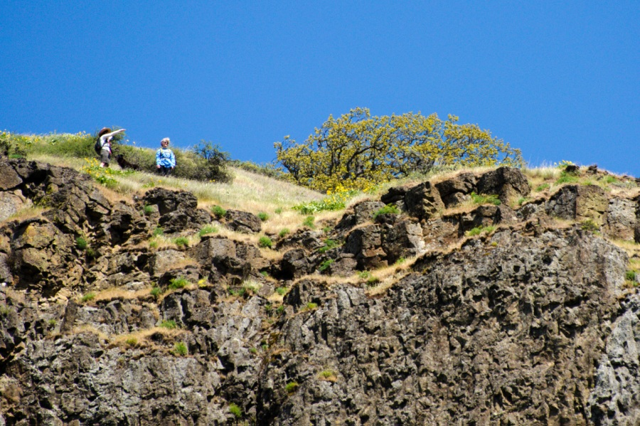 Hikers on top of the rimrock cliffs