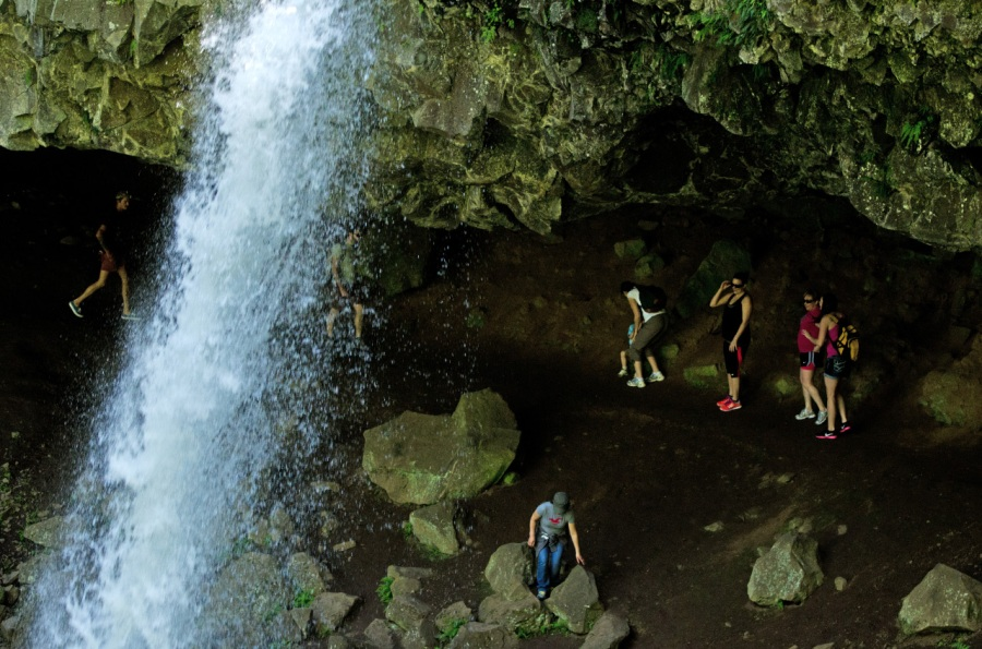 Hikers underneath Ponytail Falls
