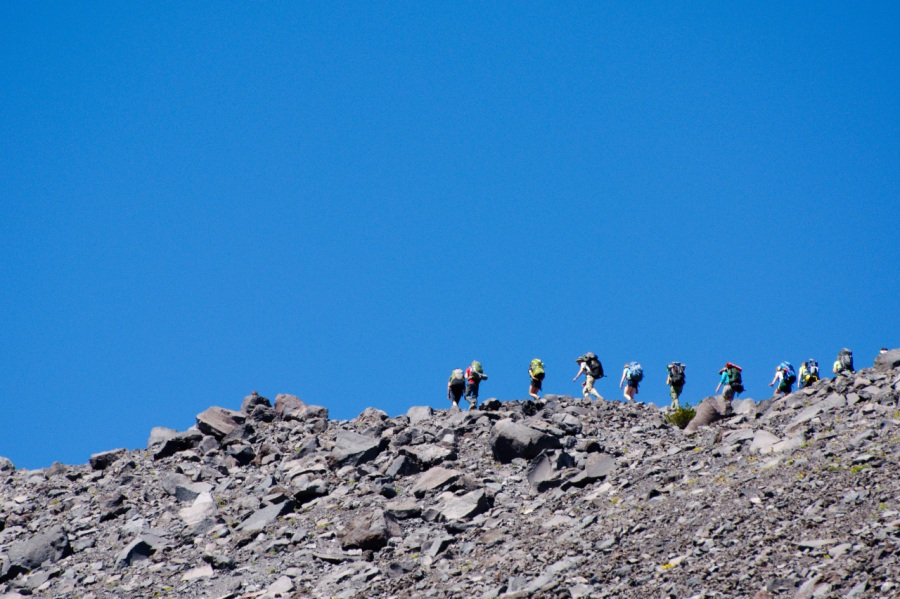 Climbers on top of glacial moraine