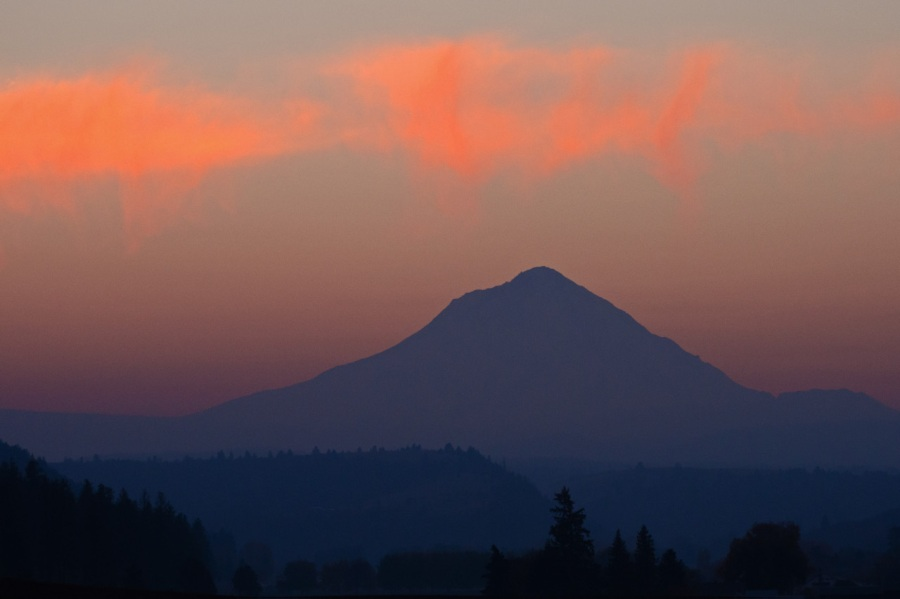 Sunrise lighting the wispy clouds over Mt. Hood