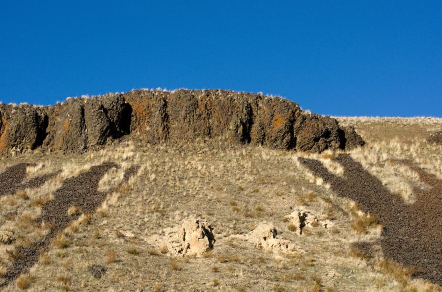 Basalt rimrocks above and John Day Formation rocks below