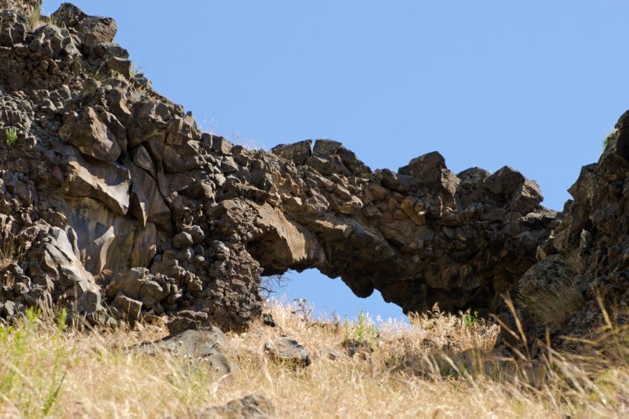 Natural arch in the basalt cliffs