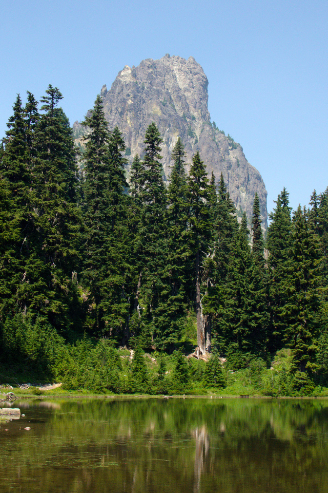6,724-foot Cathedral Rock rising above a sub-alpine tarn