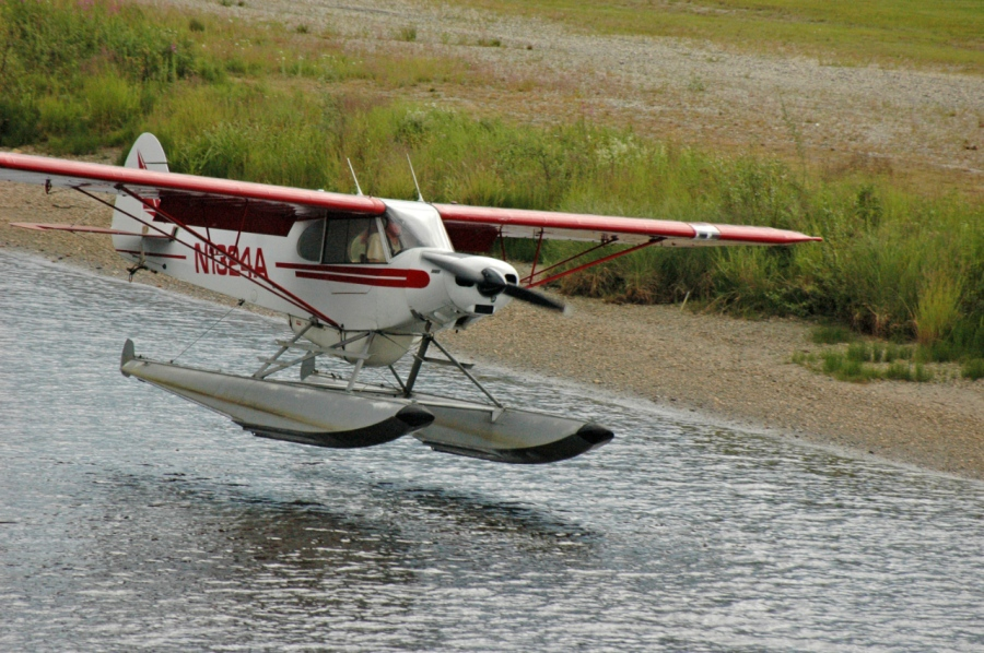 Small float plane landing on the Chena River, a common mode of transportation