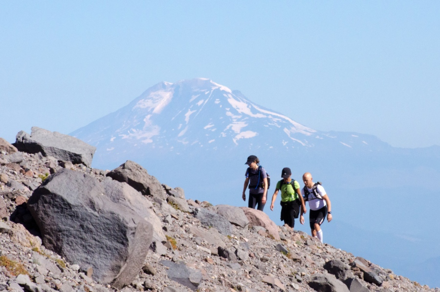 Hikers following me up the Cooper Spur Trail (Mt. Adams in background)