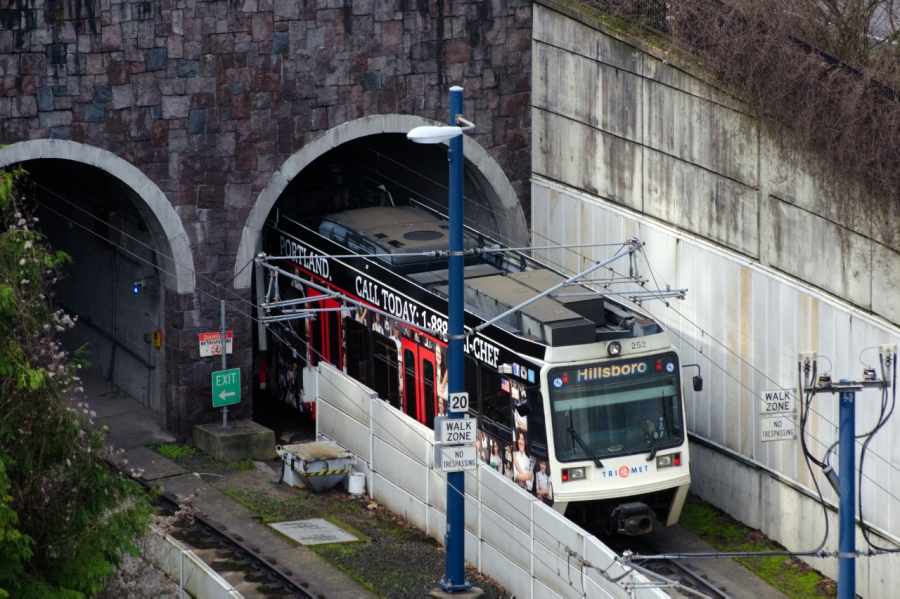 Light rail entering the tunnel underneath the West Hills