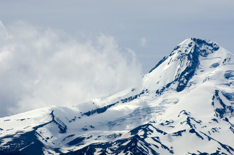 Wind blowing the snow above the Eliot Glacier on Mt. Hood