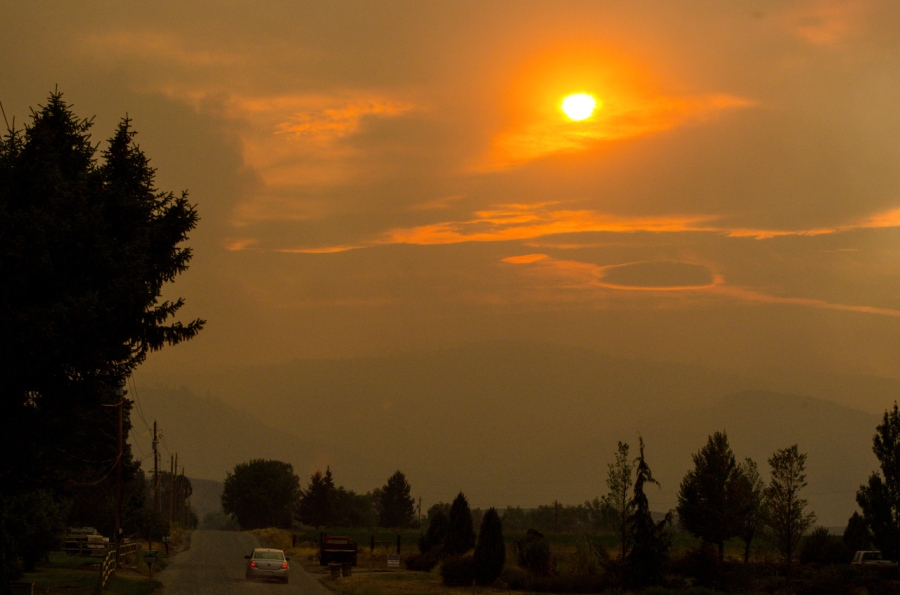 The sun trying to burn though the heavy smoke