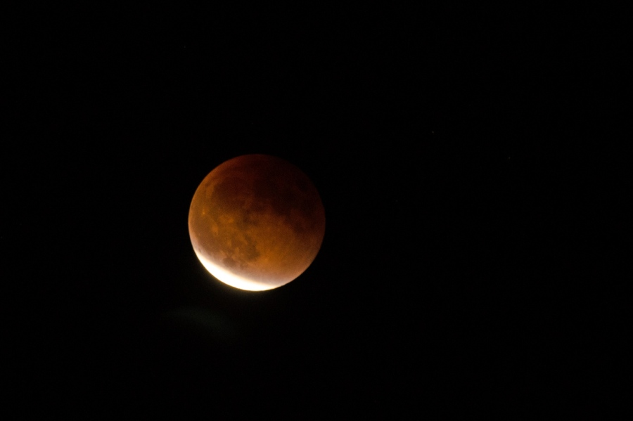 Blood Moon beginning to move out of the Earth's shadow
