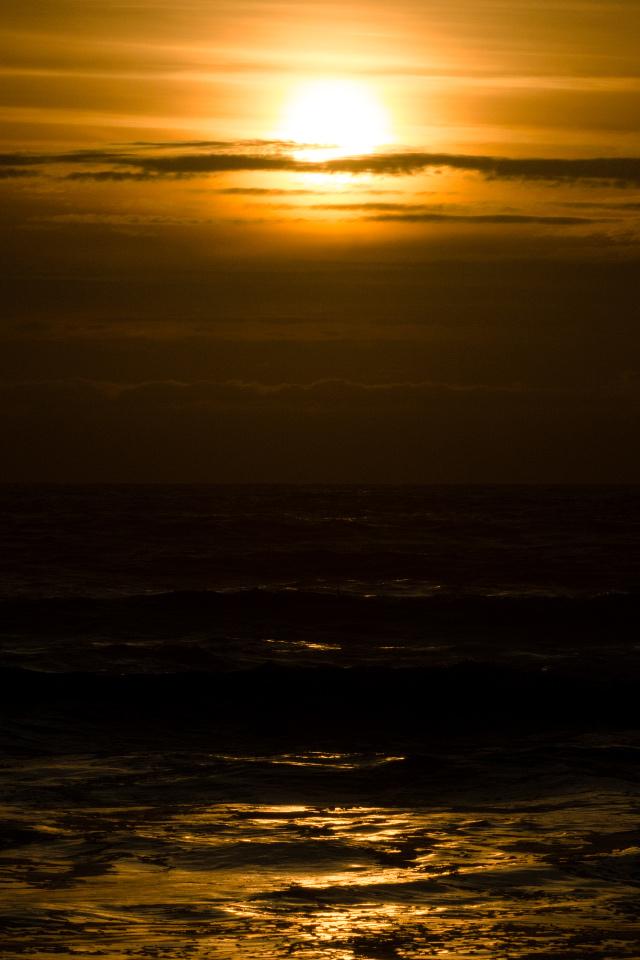Sun setting into the ocean