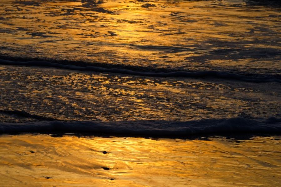 Last rays of sunlight on the beach