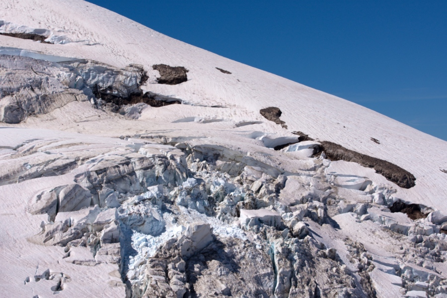 Blueish compacted snow and ground-up rocks in Eliot Glacier