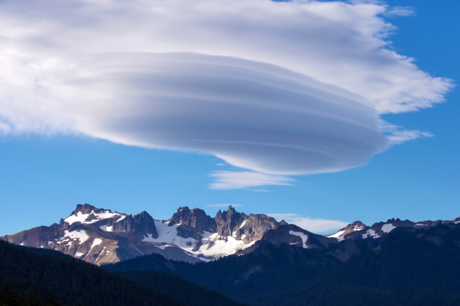 Lenticular clouds forming above Goat Rocks