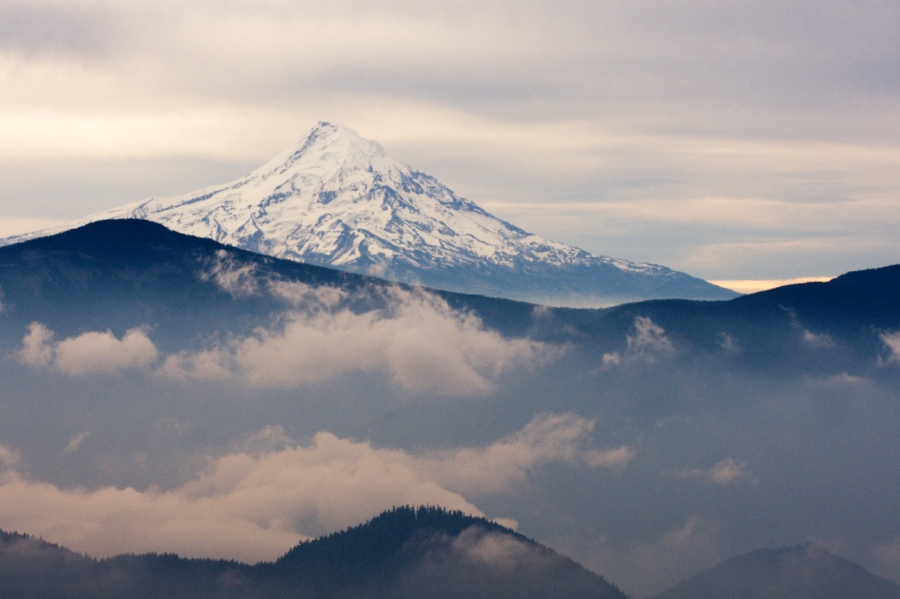 Mt. Hood beyond a cloudy Columbia River Gorge