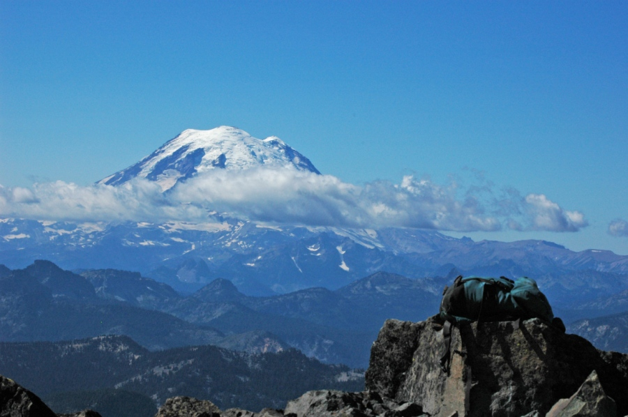 My daypack on Mt. Aix's summit with Mt. Rainier in distance