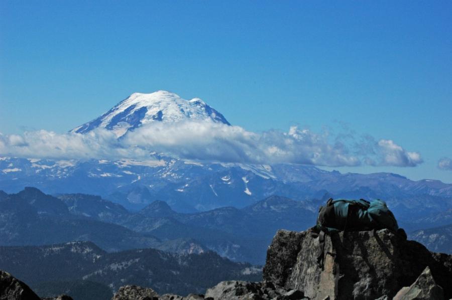 My daypack on Mt. Aix's summit with Mt. Rainier in distance